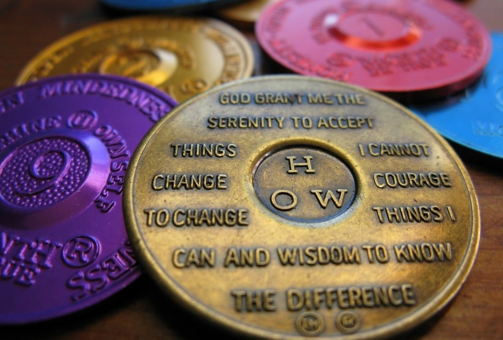 LSD therapy can support the fundamental goals of AA, embodied in the Serenity Prayer depicted on their sobriety medallions | Image Source: frankieleon via Wikimedia Commons