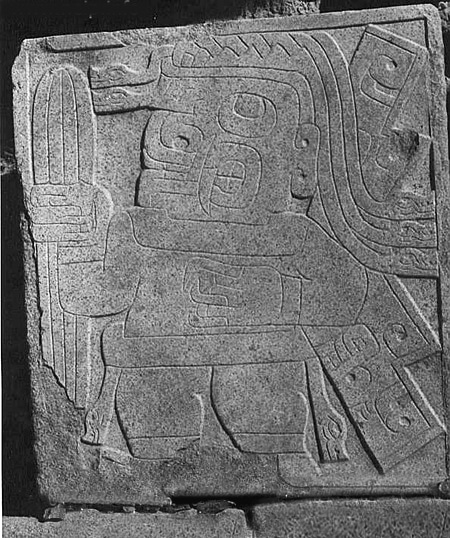 This slab, found in an ancient temple of the Chavín culture, dated around 1300 B.C.E., shows a sacred figure holding a cactus identifiable as San Pedro | Image source: Wikimedia Commons user Aristóteles Barcelos Neto